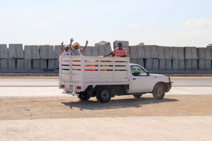Mexico: Progreso, Mexico :: Shipyard workers wave and smile at the camera. More Info