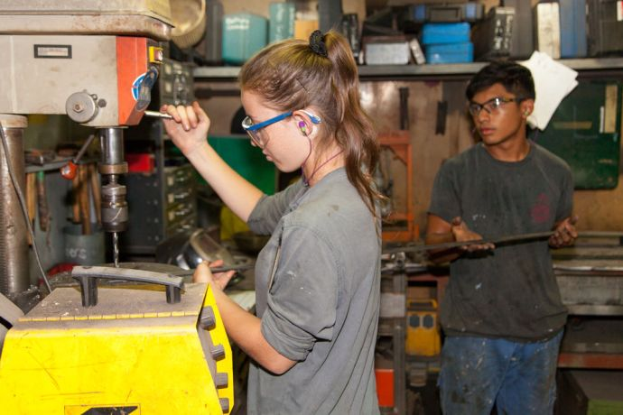 Mexico: At Sea :: Vera Bandmann (Namibia) and Michael Bukit (Canada) use the drill in the maintenance workshop. More Info