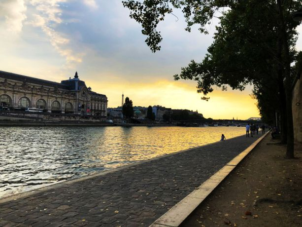 France: Sitting by the Seine with a view of Musee dOrsay and the Eiffel Tower. More Info