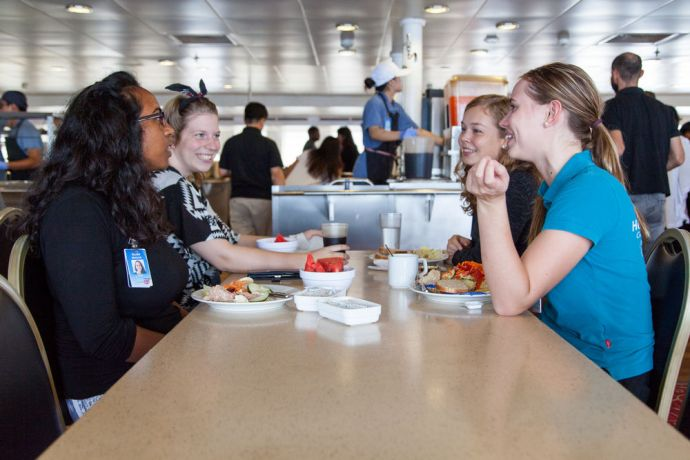 Mexico: At Sea :: Crewmembers enjoy lunch together on board Logos Hope. More Info