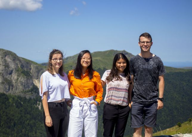 France: A group of young adults from all over the world stands together before hiking Puy Mary for a free day activity during the Cantal Unreached Outreach in France. More Info