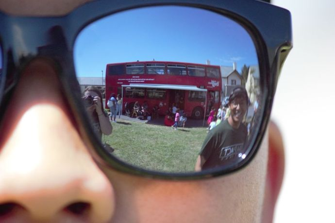 Ireland: The Big Red Bus is reflected in sunglasses. More Info