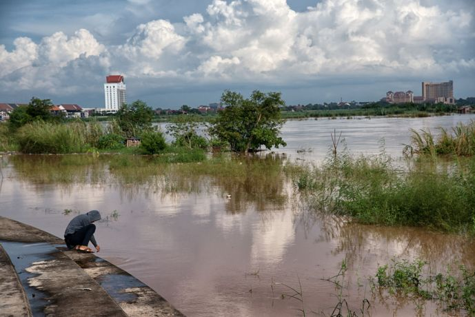 Laos: The Mekong River in Vientaine, Laos. The beach and homes in the river are completely or mostly submerged due to flooding. More Info