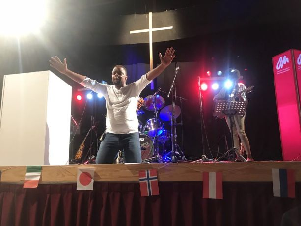 Spain: Transform Director Mpumi Maweni (South Africa) praying for participants responding to alter call for long term ministry. More Info