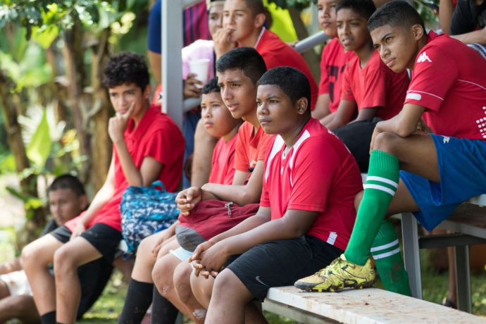 Panama: Balboa, Panama :: Teenage boys listen intently as the gospel is shared during a sports ministry event. More Info