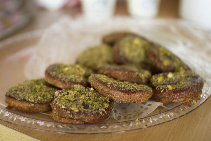 Arabian Peninsula: A typical local treat with helua and crumbled pistachios on top, in the Arabian Peninsula.  Photo by Kathryn Berry More Info