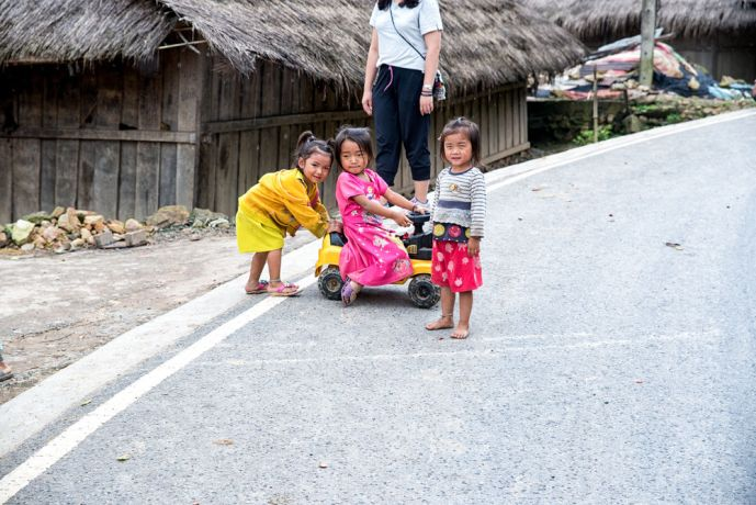 Laos: Children playing on a mountain road. More Info