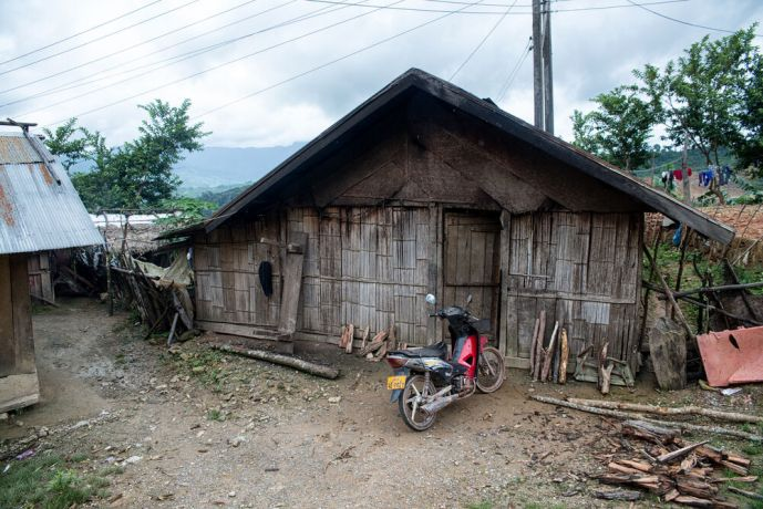 Laos: Traditional home in a mountain village. More Info