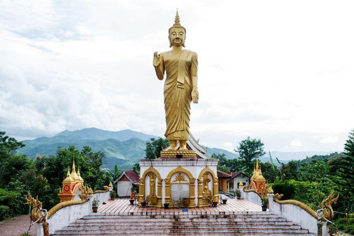 Laos: Statue in a Buddhist Temple. More Info