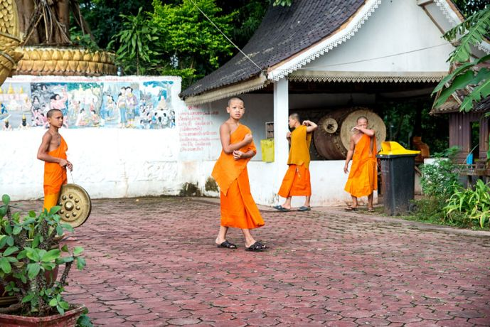 Laos: Buddhist monks at a temple. More Info