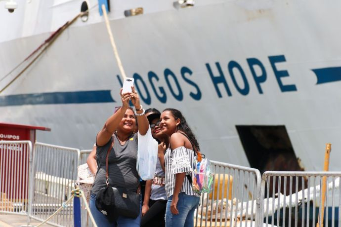 Panama: Balboa, Panama :: Four visitors take a selfie on the quayside beside Logos Hope. More Info