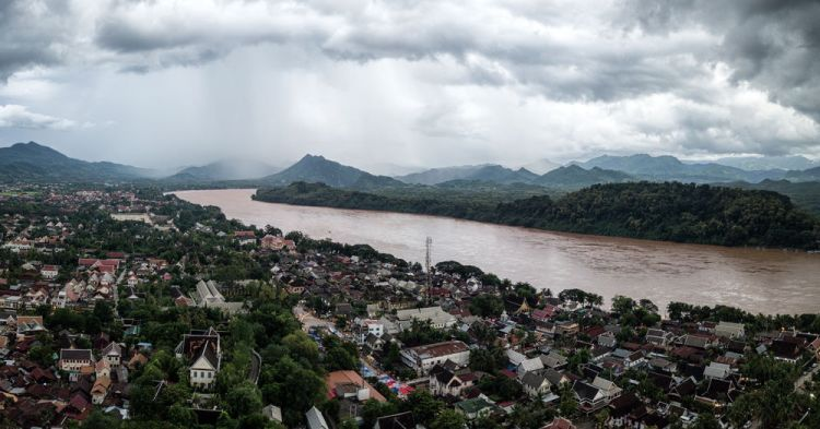 Laos: A muddy Mekong River flows past the city of Luang Pradang. More Info