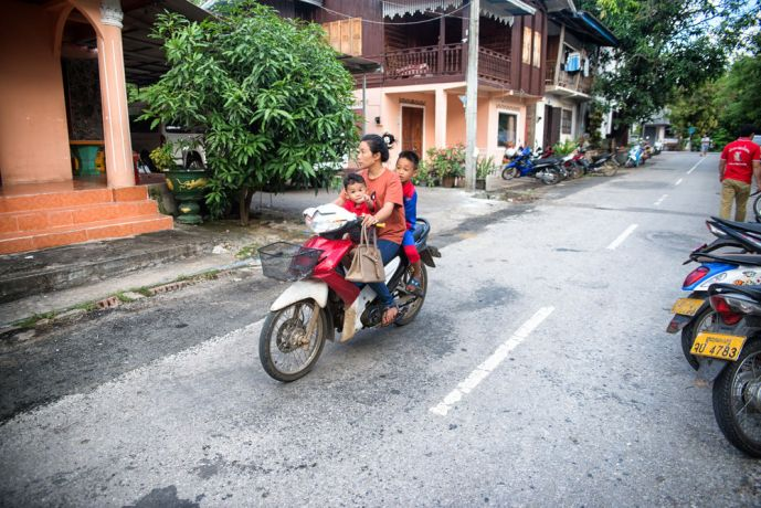 Laos: A mother and two kids getting around on motorbike. More Info