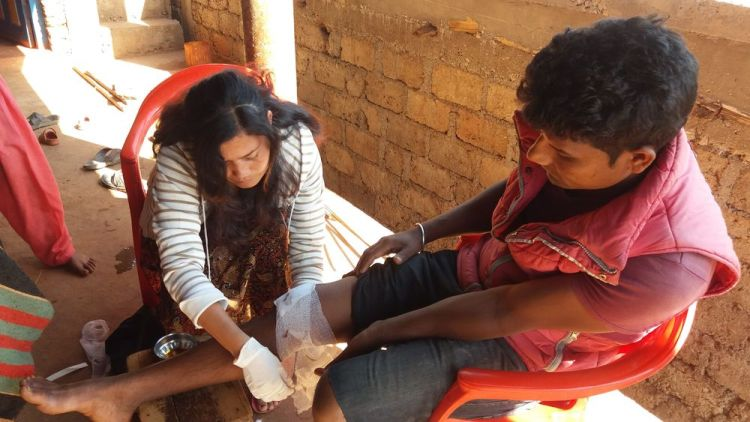 South Asia: OM worker helps one villager with his injury More Info