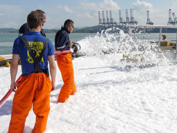 Panama: Balboa, Panama :: Crewmembers and port naval officers test foam cannons on the quayside. More Info