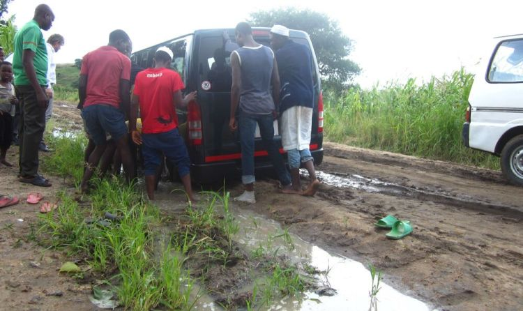 Malawi: People discuss the best way to get a vehicle out of mud. More Info