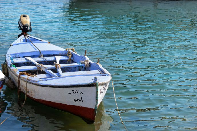 Near East: The wooden fishing boats of Lebanon wait for the fishermen to arrive.  Photo by Julie Coleman More Info