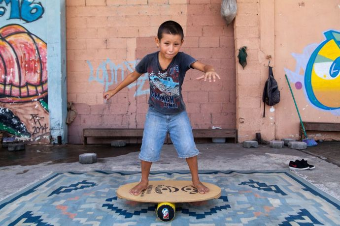 Guatemala: Puerto Quetzal, Guatemala :: A child learns how to balance at Motivo Urbano, a nonprofit that uses skateboarding as a tool to connect with children and young people. More Info