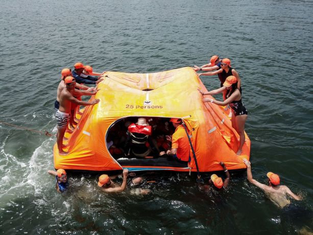 Guatemala: Puerto Quetzal, Guatemala :: Logos Hope crew train new recruits how to survive at sea using a life raft. More Info