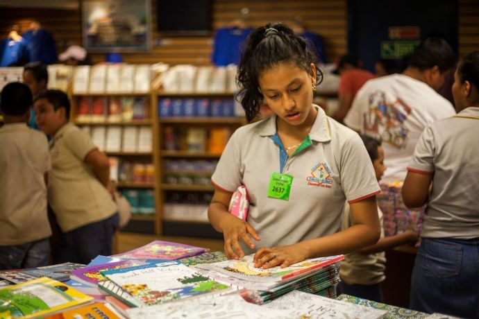 Guatemala: Puerto Quetzal, Guatemala :: A teenage girl browses through the bookfair on board Logos Hope. More Info