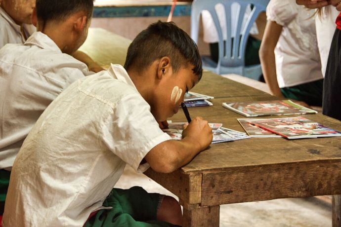 Thailand: Students receive their notebooks on the first day of class at the School of Mercy, operated by OM MTI for 130 internally displaced Mon and Karen children in a village at the Thailand-Myanmar Border. More Info