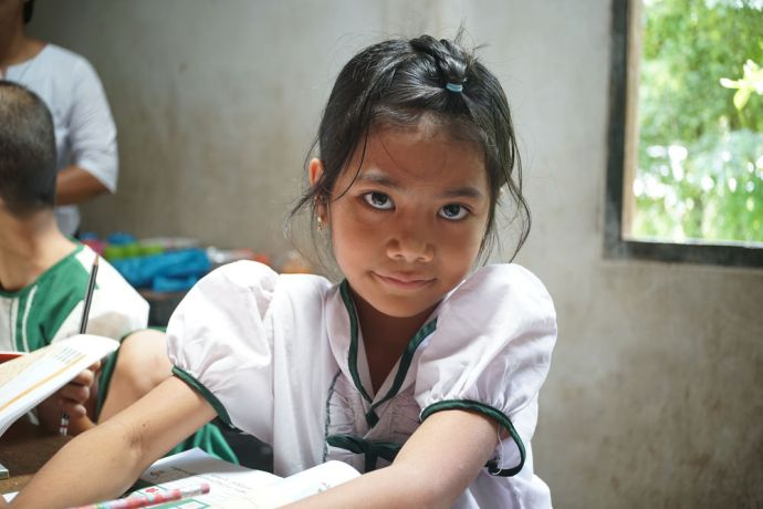 Myanmar: Portrait of a young girl in school in Myanmar. More Info