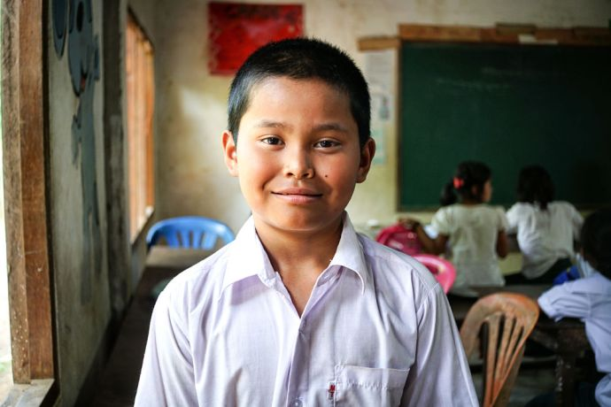 Myanmar: Portrait of a boy in school in Myanmar. More Info