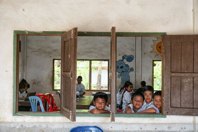 Myanmar: A couple boys looking out of a classroom window in their school in Myanmar. More Info