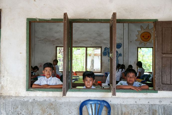 Myanmar: A couple boys looking out their classroom window at school in Myanmar. More Info