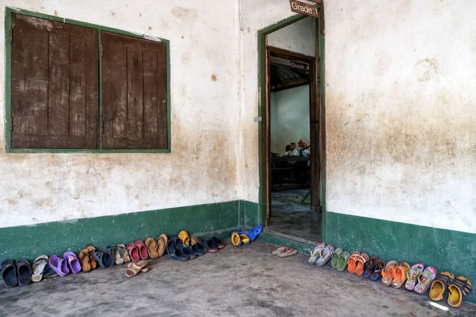 Thailand: Students shoes lined up neatly outside of the classroom  at the School of Mercy, operated by OM MTI for 130 internally displaced Mon and Karen children in a village at the Thailand-Myanmar Border. More Info