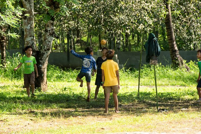 Myanmar: Kids in Myanmar playing Chinlone, also known as caneball, where the ball used is normally made from handwoven rattan. More Info