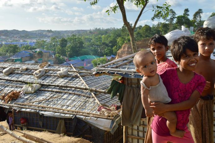 Bangladesh: Rohingya children, who live in one of the largest refugee camps in the world, smile at visitors. More Info