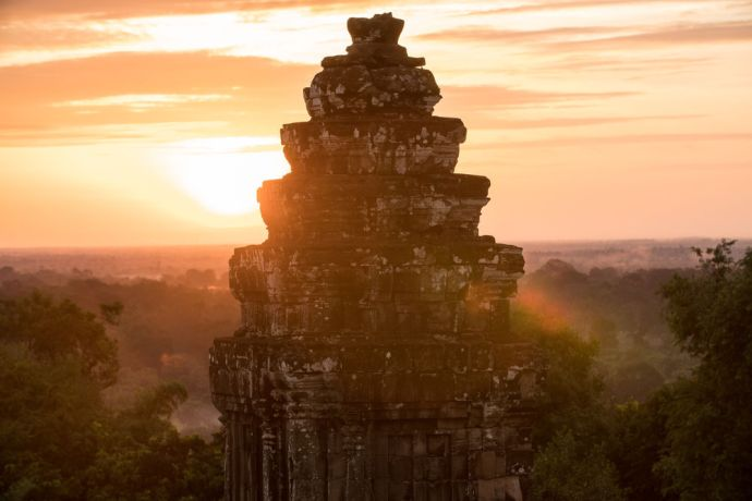 Cambodia: The sun rises behind one of the temples in Cambodias iconic Angkor Wat complex. Photo by Jay More Info