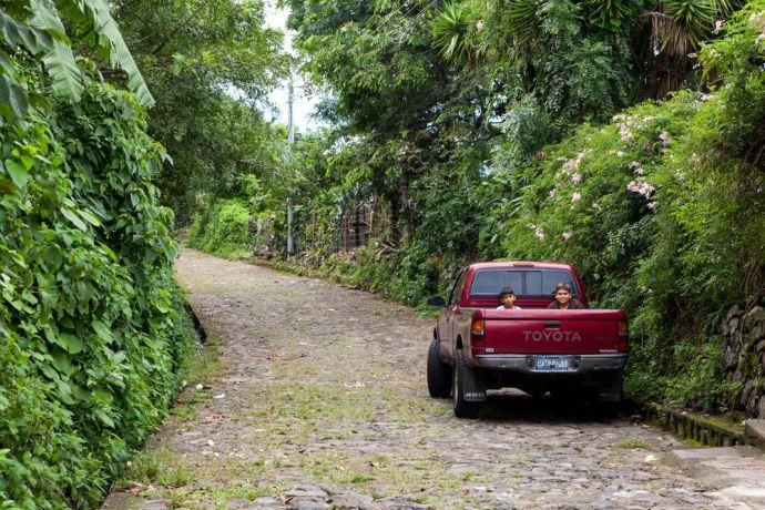El Salvador: La Union, El Salvador :: Two children hang out in the back of a truck. More Info