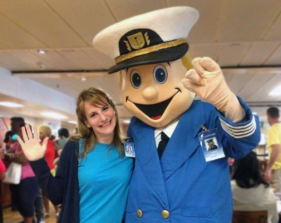 Hungary: Tünde Ujlaki (Hungary) smiles with El Capitano, the Logos Hope mascot, onboard the ship. Tünde served in the catering department on the Logos Hope in 2017. More Info
