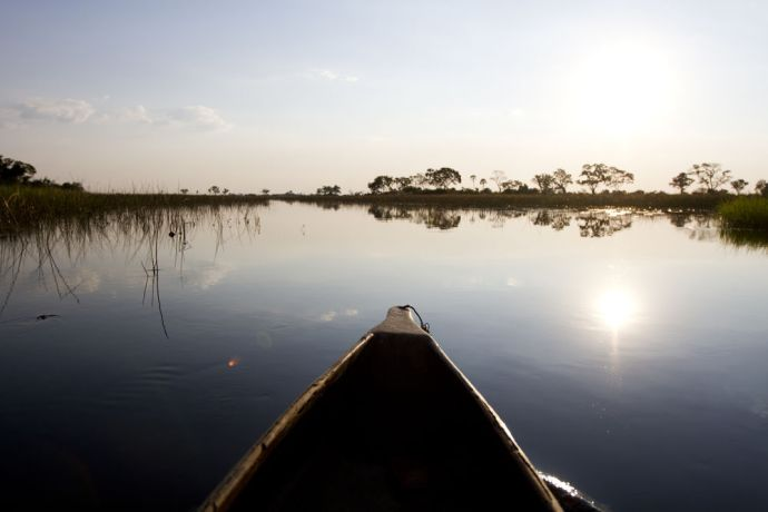 South Africa: A canoe paddles on a lake. More Info