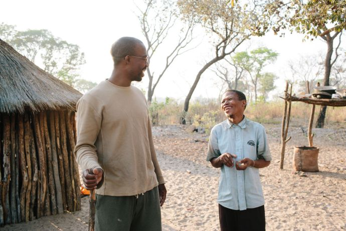 Angola: OM Angola trainer Ngunza Caombo talks with a local bushman. More Info