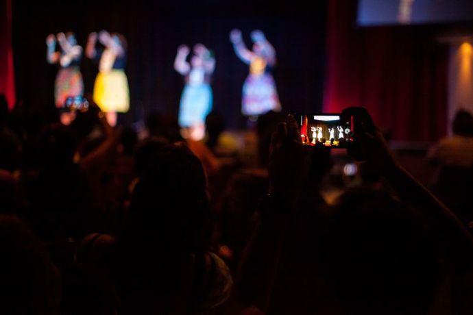 El Salvador: La Union, El Salvador :: Crewmembers perform a hula dance in the onboard theatre. More Info