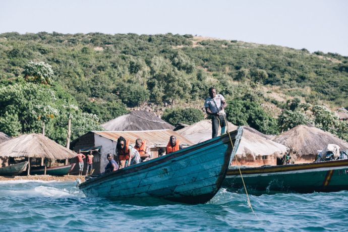 Zambia: Lake Tanganyika missionaries travelling on a boat to different villages. More Info