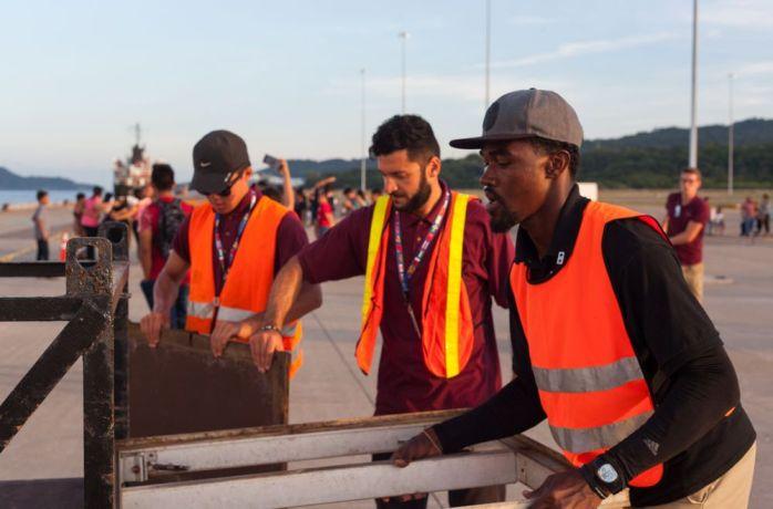 El Salvador: La Union, El Salvador :: Shurendy Zimmerman (ABC Islands), Stepan Vardanian (Armenia) and James Jo (South Korea) help pack down the quayside of Logos Hope. More Info