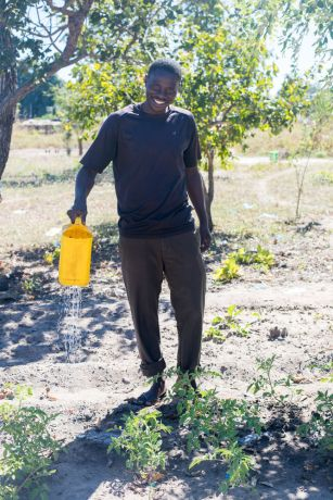 Mozambique: OMer James waters his garden in northern Mozambique. More Info