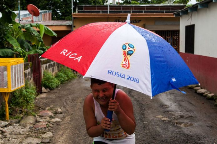 Costa Rica: Puntarenas, Costa Rica :: A young boy laughs in the rain. More Info