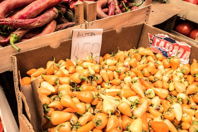 Serbia: Box of orange peppers at a market in Eastern Serbia. More Info