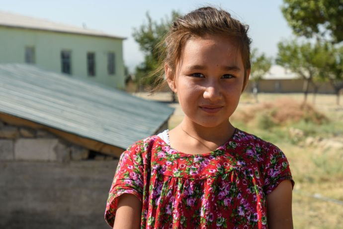 Central Asia: A young girl poses for her portrait in Central Asia.  Photo by Garrett N More Info