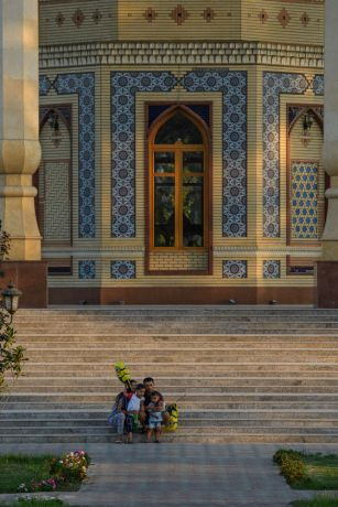 Central Asia: A family sits at the base of a monument taking a selfie in Central Asia.  Photo by Garrett N More Info
