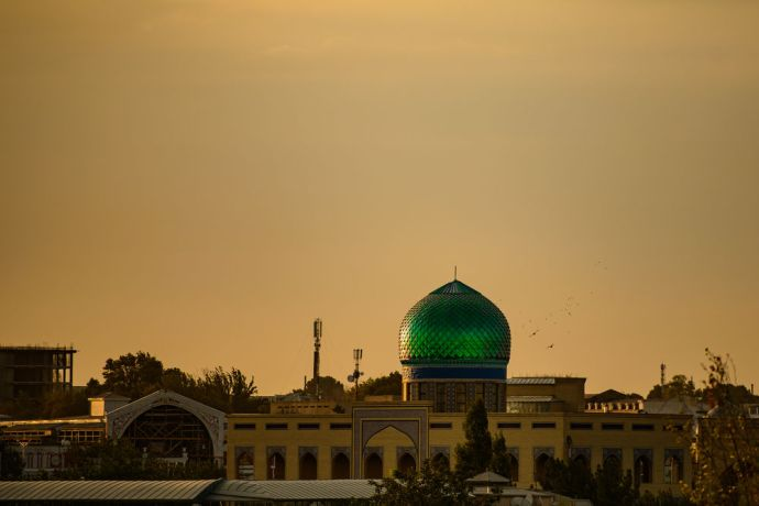 Central Asia: The sun rises on a mosque in Central Asia.  Photo by Garrett N More Info