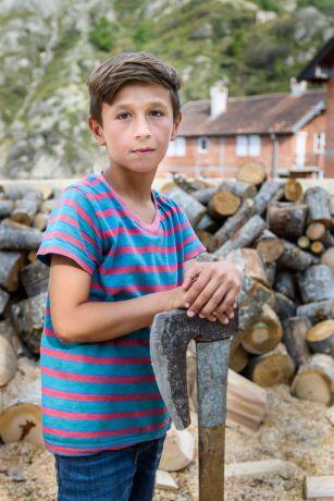 Kosovo: Portrait pf. young boy with an ax in a Dragash village in Kosovo.  Photo by Garrett N More Info