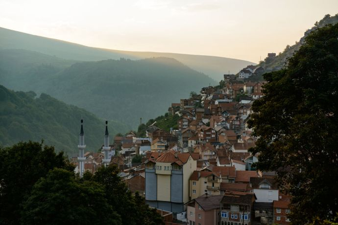 Kosovo: A Dragash village with a mosque in the evening light.  Photo by Garrett N More Info