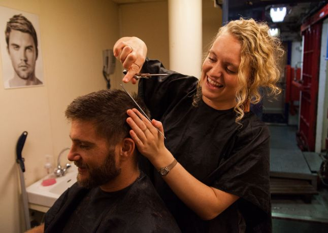 Costa Rica: Puntarenas, Costa Rica :: Aubrey Hart (US) gives Riaan Grobler (South Africa) a haircut. More Info
