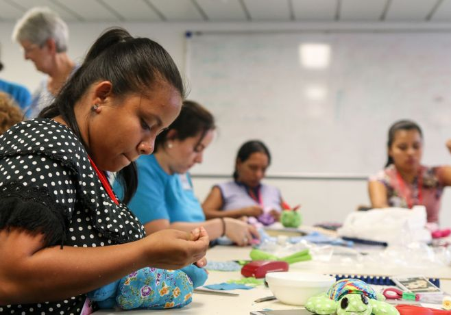 Costa Rica: Puntarenas, Costa Rica :: Women learn different sewing skills at a workshop held on board Logos Hope. More Info